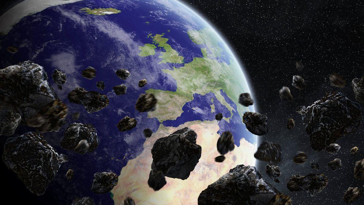 Illustration eines Asteroideneinschlags auf der Erde - Symbolbild