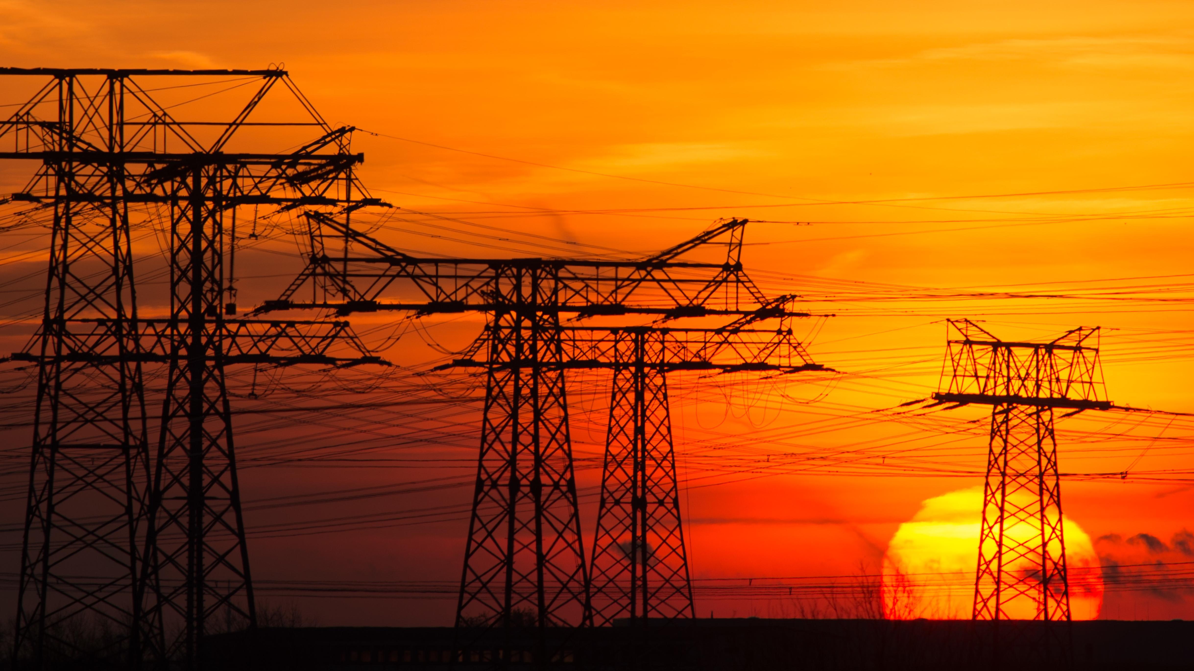 Symbolbild von Strommasten in Deutschland