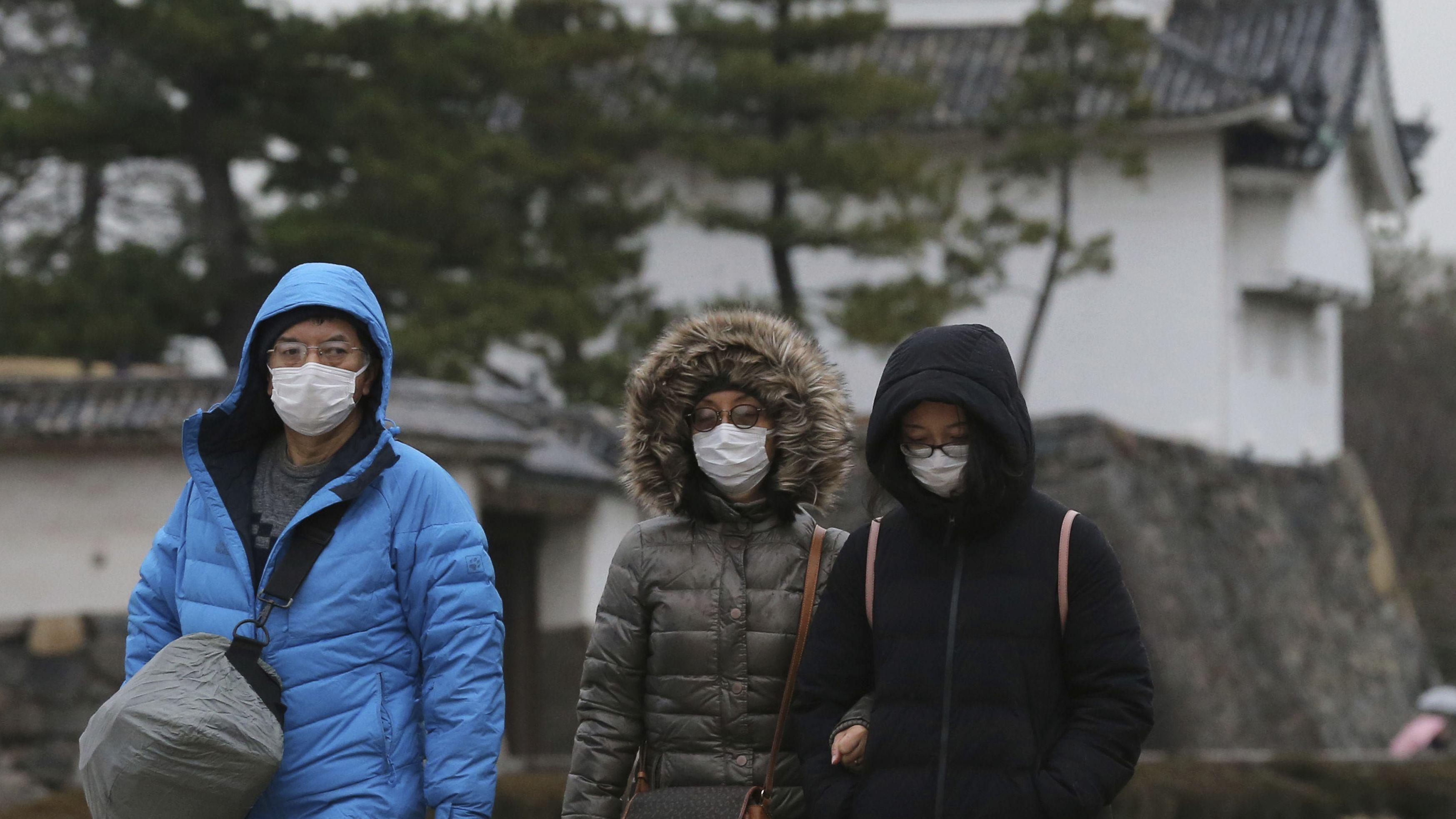 Chinesen schützen sich mit Mundschutz