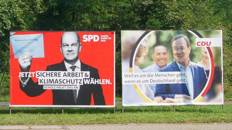 Wahlplakate von SPD und Union | Bild:picture alliance / Wolfgang Minich | Wolfgang Minich