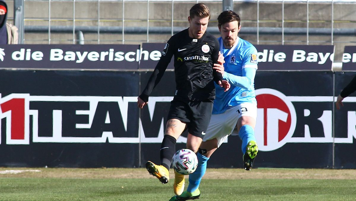 SV 1860 Muenchen vs. FC Hansa Rostock v. li. im Zweikampf  Philip Türpitz / Tuerpitz (FC Hansa Rostock) und Dennis Erdmann (TSV 1860 Muenchen)