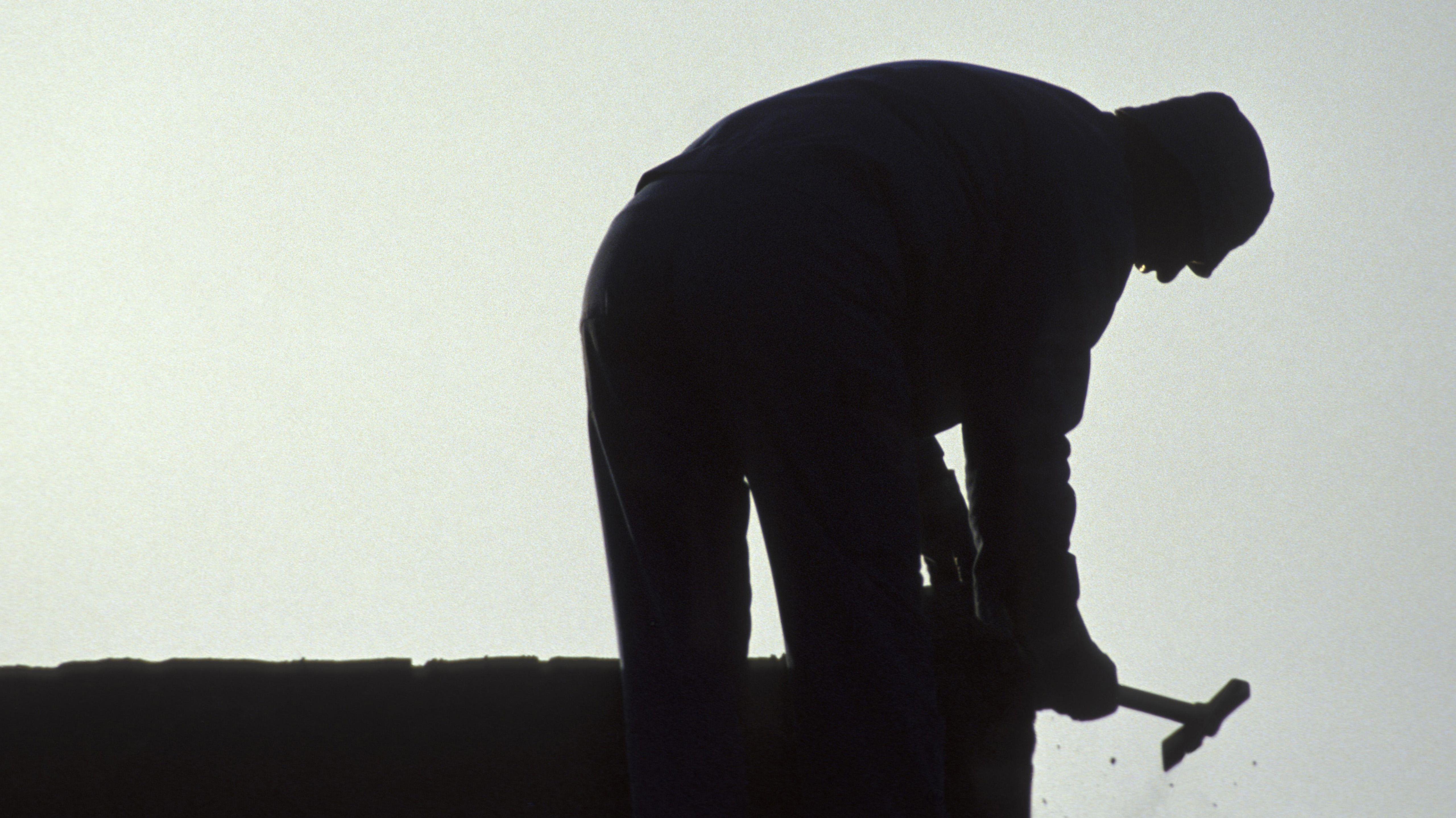 Silhouette eines Handwerkers