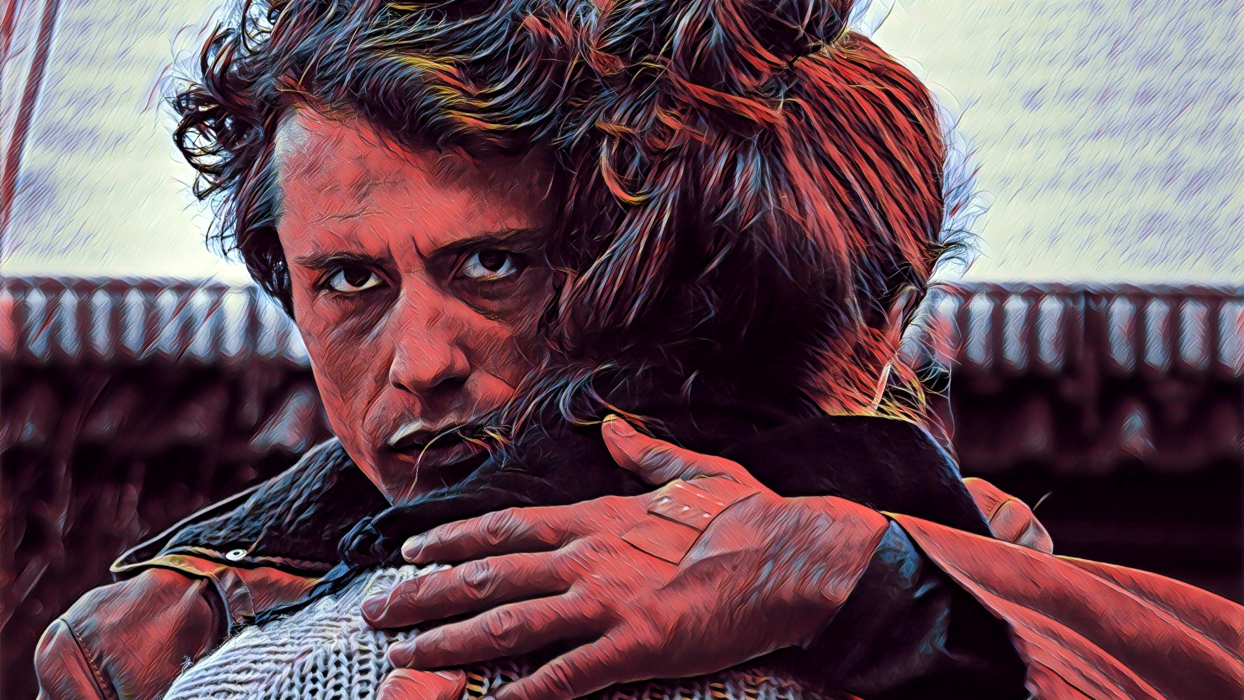 Filmszene aus Freddy/Eddy: Ein Mann blickt über die Schulter einer Frau in Richtung Kamera