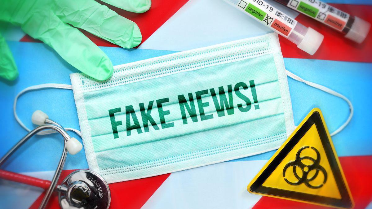 """Symbolbild zu """"Fake News"""" mit Maske, Teströhrchen und einem Warnschild für Biogefährdung."""