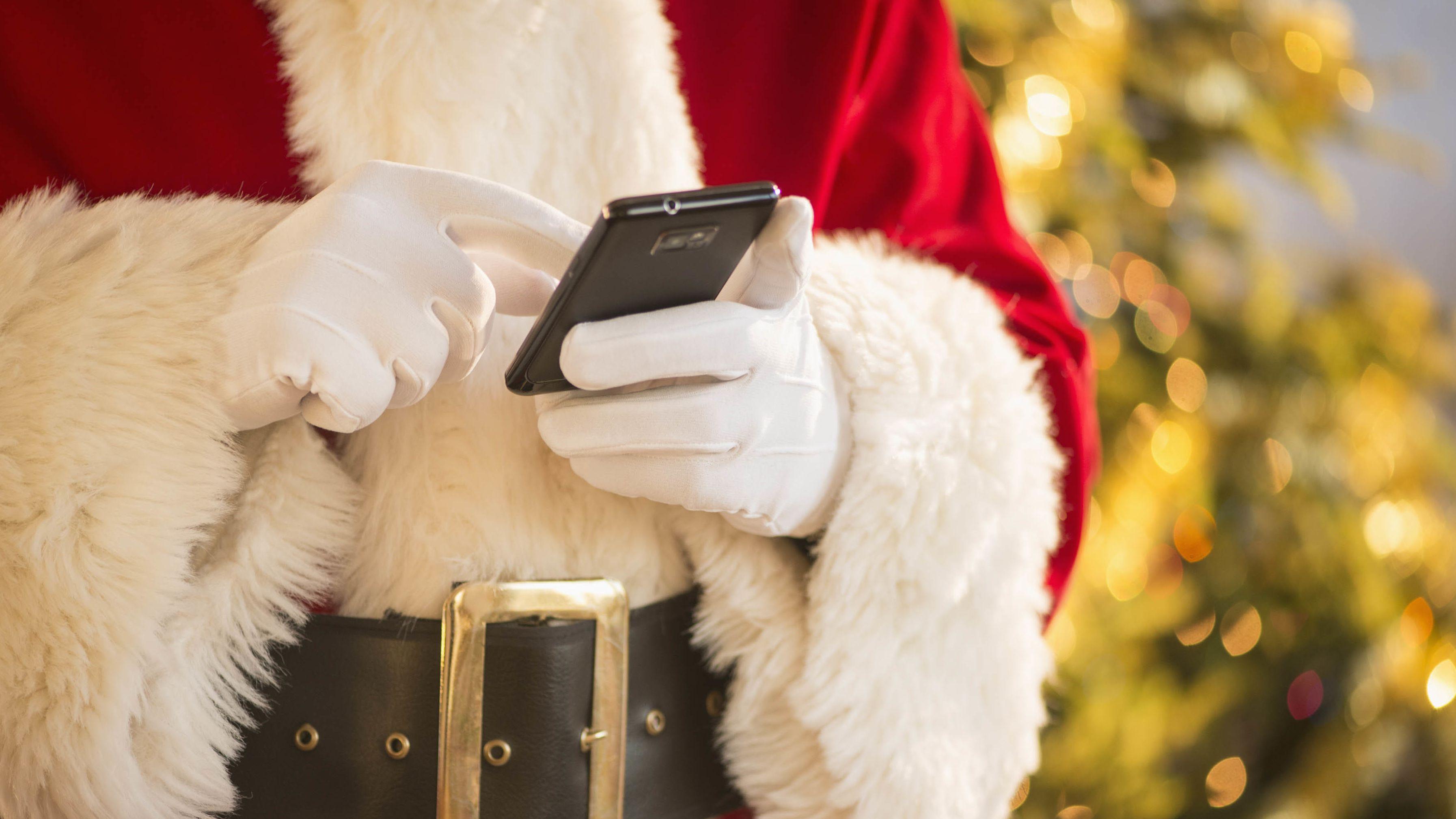 Weihnachtsmann mit Handy