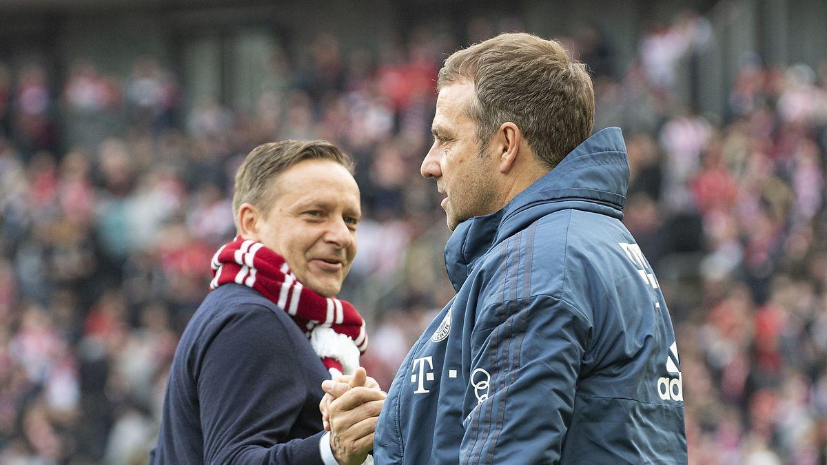 Hansi Flick (r.) und Kölns Manager Horst Heldt