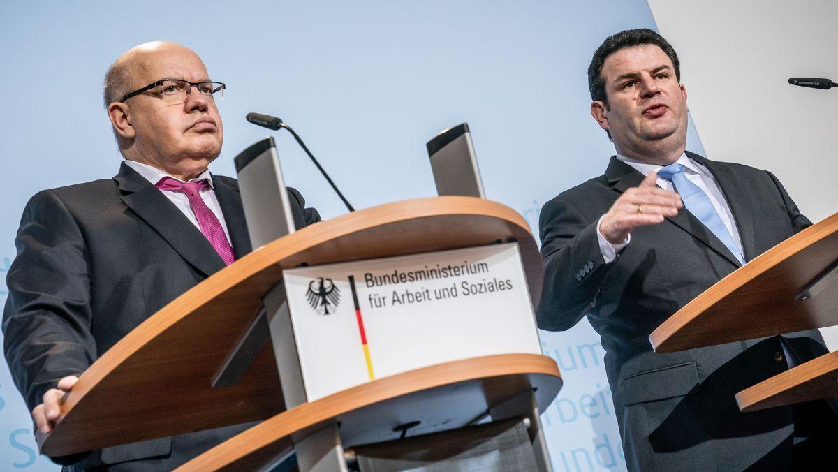 Peter Altmaier (CDU, l) neben Hubertus Heil (SPD)