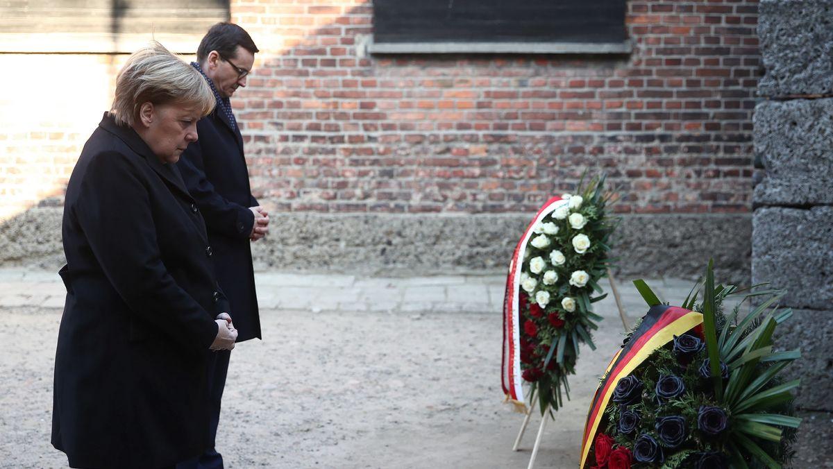 Bundeskanzlerin Angela Merkel mit dem polnischen Premierminister Mateusz Morawiecki in Auschwitz