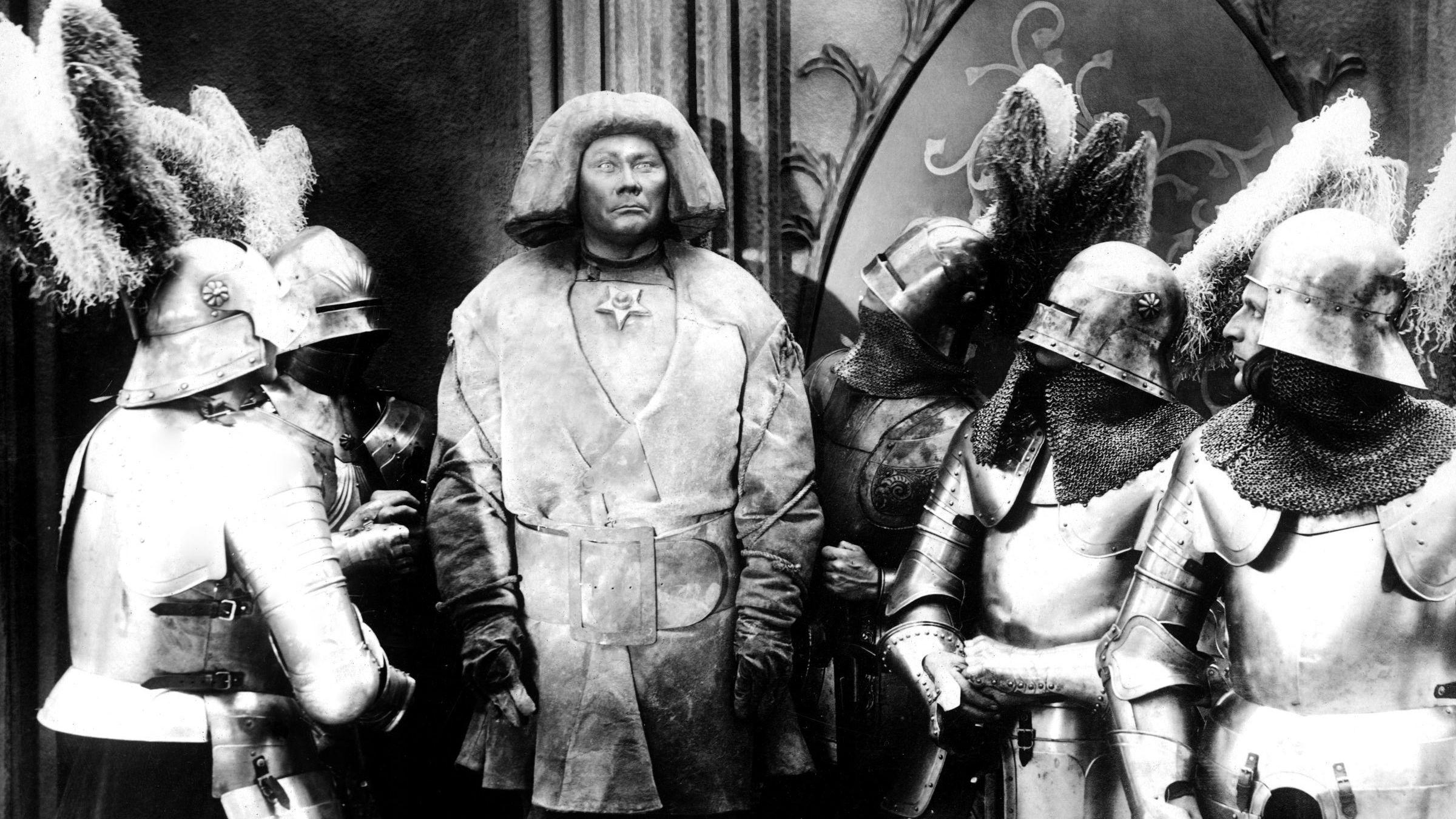 """Szene aus dem Stummfilm """"Der Golem, wie er in die Welt kam"""" (1920)"""