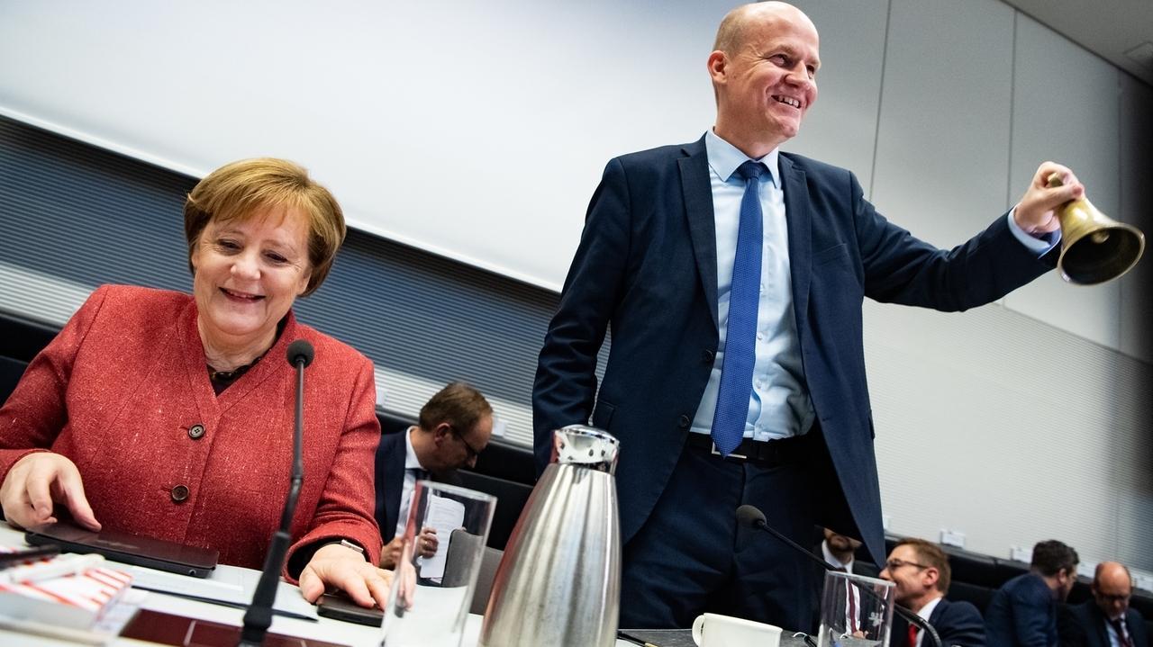 Ralph Brinkaus (rechts), Kanzlerin Angela Merkel