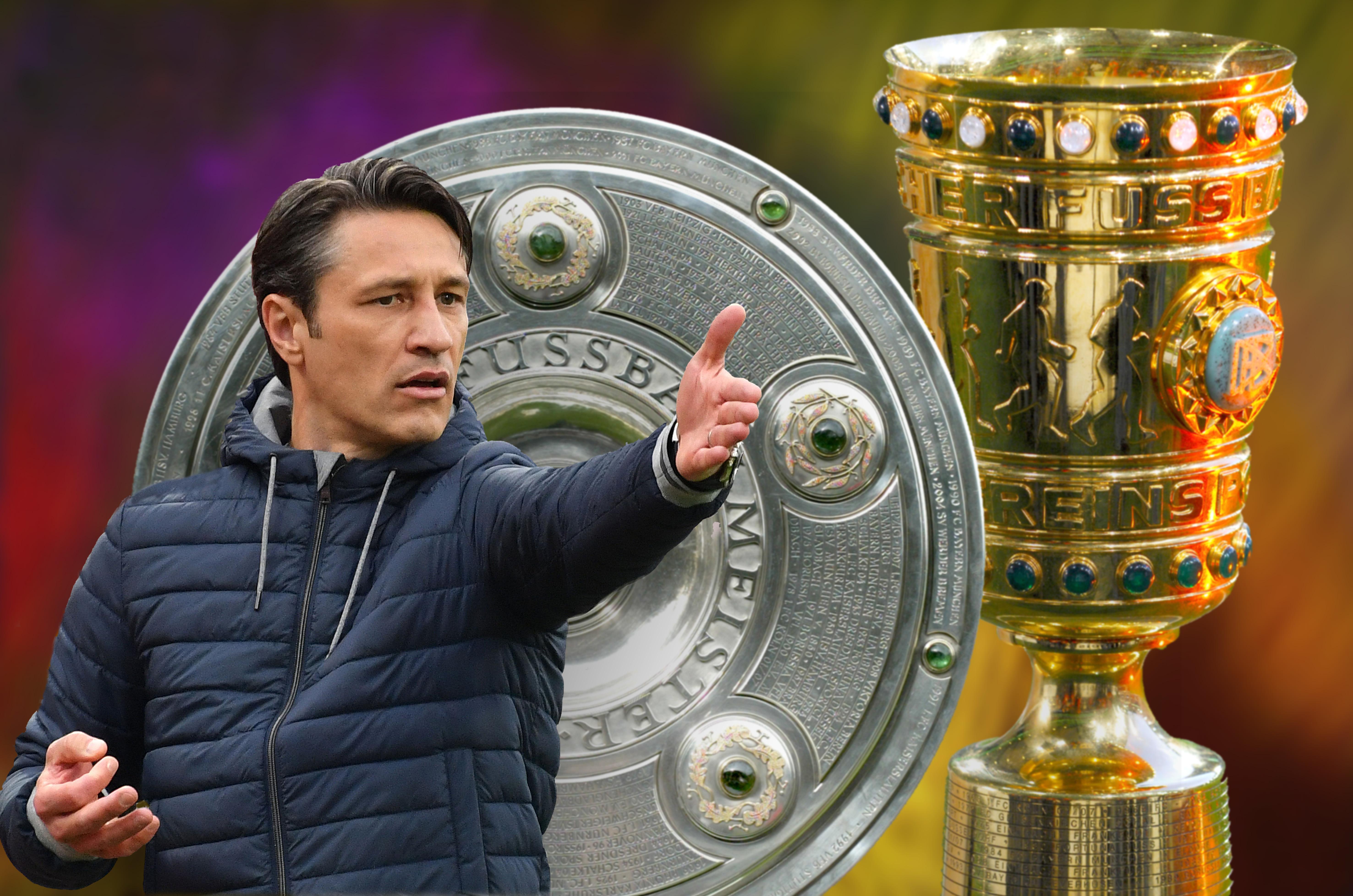 Niko Kovac vor der Meisterschale und DFB-Pokal