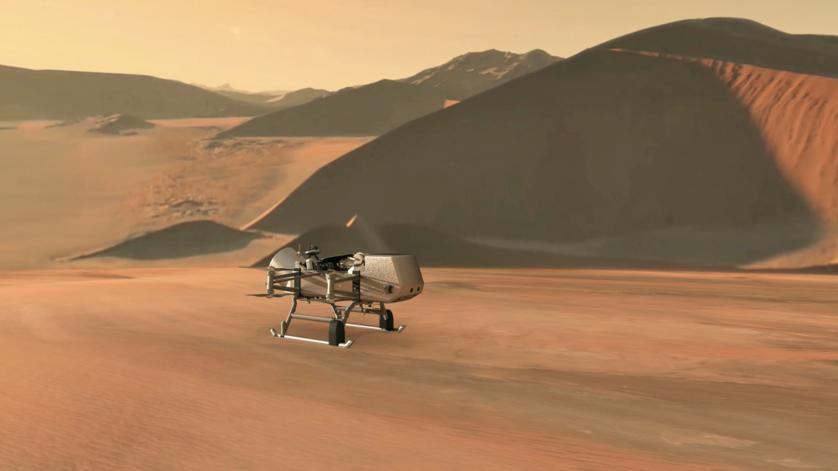"""Acht Rotoren machen die geplante Sonde Dragonfly der NASA zur ersten Sonde, die sich fliegend über einen fernen Himmelskörper bewegen wird. Fast drei Jahre lang soll die """"Libelle"""" den Titan erkunden, Saturns größten Mond."""