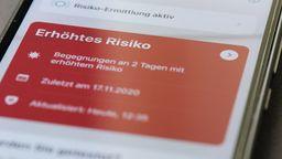 Rote Warn-Meldung in der Corona-Warn-App.   Bild:Picture Alliance