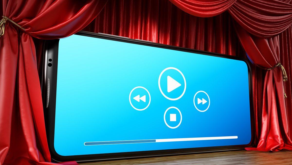 Symbolbild digitale Kulturvermittlung: Smartphone-Display mit Theater-Vorhang