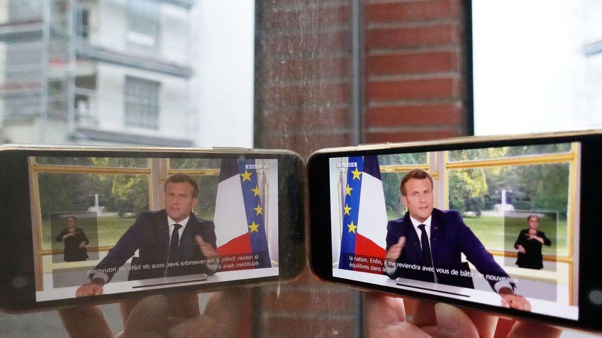 Der französische Präsident Emmanuel Macron bei seiner Fernsehansprache am 14. Juni zu sehen auf einem Handydisplay.