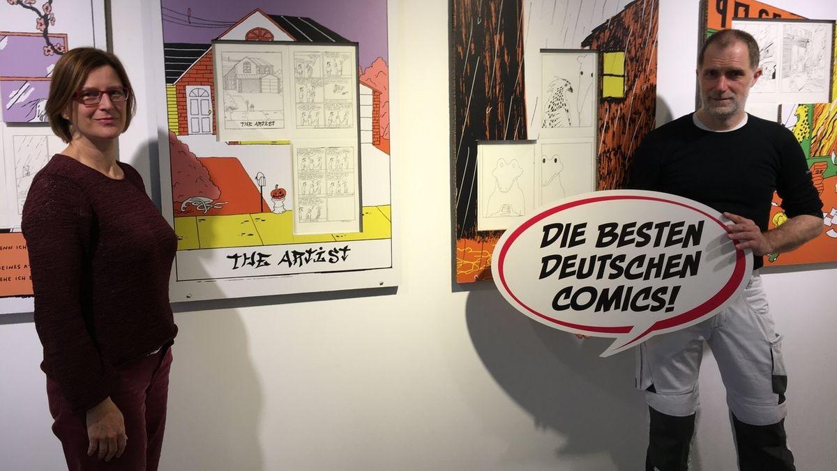 Museumsleiterin Alexandra Hentschel und Kurator Darjush Davar im präsentieren im Comicmuseum die ihre Ausstellung.