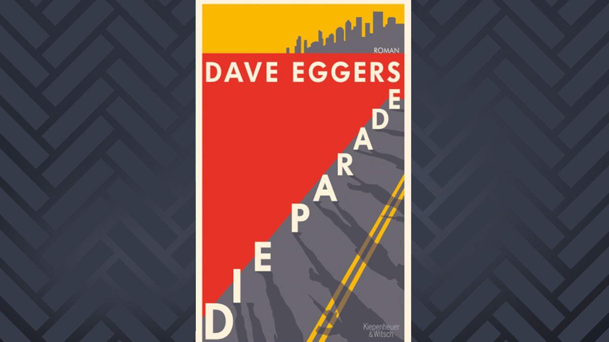 """Buch das diagonal von einer großen Straße auf der Schatten einer Militärparade zu sehen sind. Dave Eggers Roman """"Die Parade"""""""