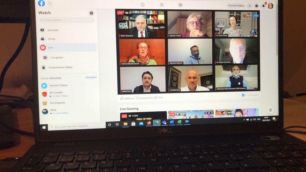 Bildschirm eines Computers mit Bild einer Video-Konferenz